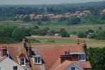 50: The countryside of inland Suffolk stretches away in the distance in the haze of a hot sunny day, as the Water Towers of Southwold Common come back into view.